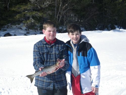Spencer Knowles and Branden Olsen of Bath liked this big ole Moosehead Lake Salmon so much, they invited him home for dinner!