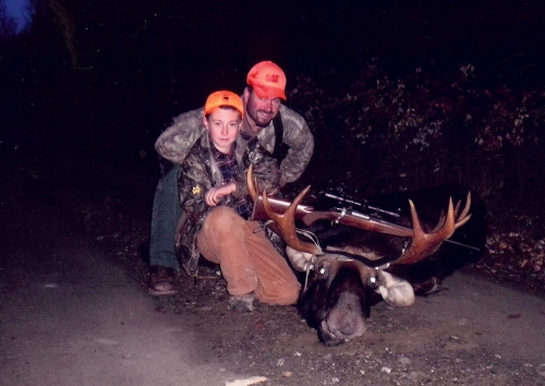Father and son, Craig and John Watt stop for a pose following a successful moose hunt in late 2010. ~Contributed Photo