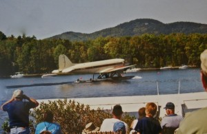 The famous DC-3 takes off at Fly-In some years ago with Lou Hilton and Max Folsom at the controls. Photo courtesy of the Moosehead Historical Society